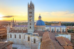 Siena sunset panoramic view. Cathedral Duomo landmark. Tuscany,