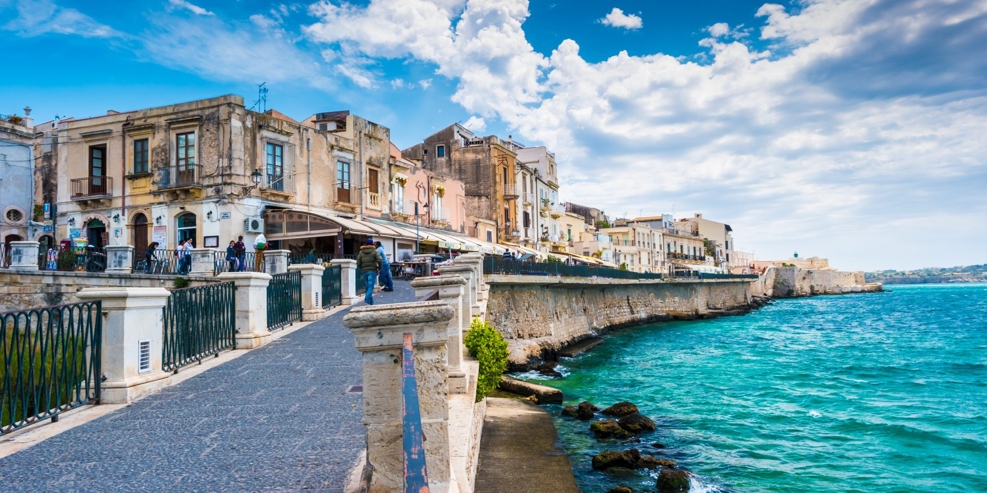 Coast of Ortigia island at city of Syracuse, Sicily, Italy.